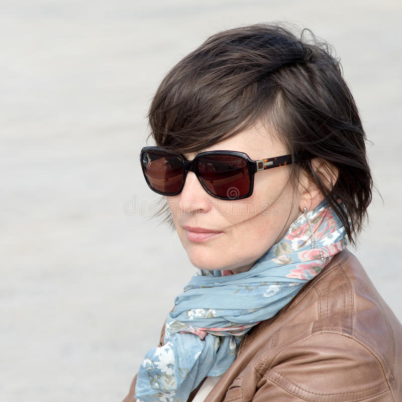 Closeup of a female in sunglasses stock image