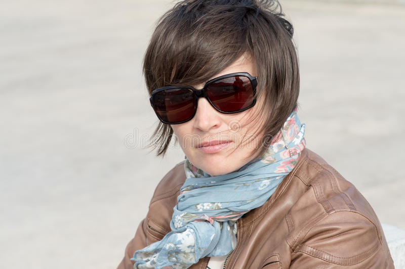 Closeup of a female in sunglasses stock photos