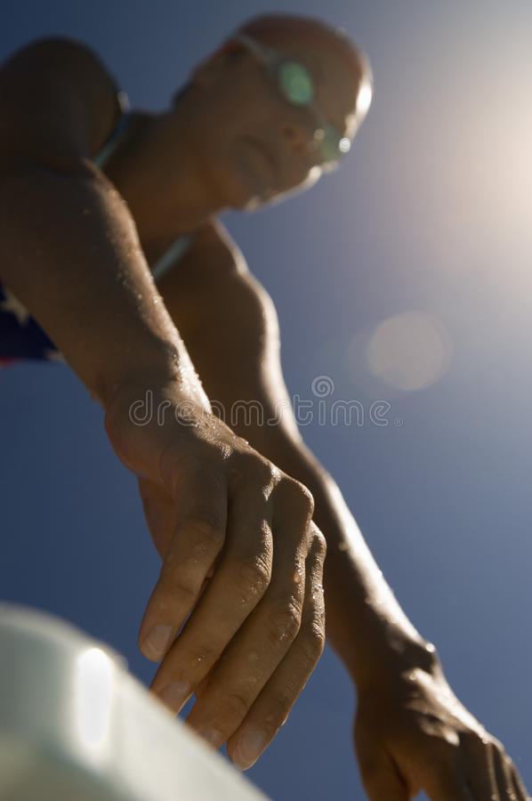 Closeup Of Female Swimmer At Starting Blocks stock photos