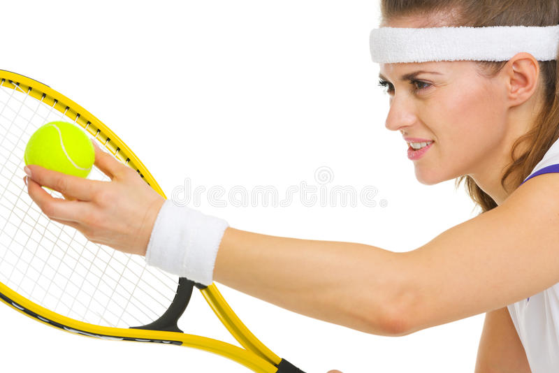 Download Closeup On Female Tennis Player Serving Ball Stock Image - Image: 31661095
