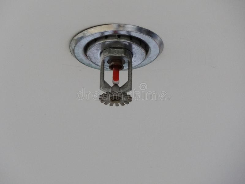 Closeup of Fire sprinkler install on white high ceiling royalty free stock image