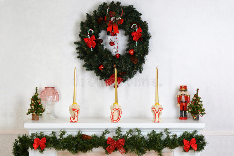 Closeup fireplace mantel with wreath. And candles royalty free stock images
