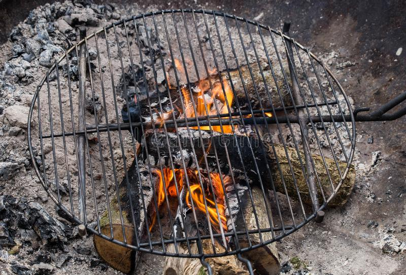 Closeup of firewood burning in fire cooking place outside. Camping royalty free stock images