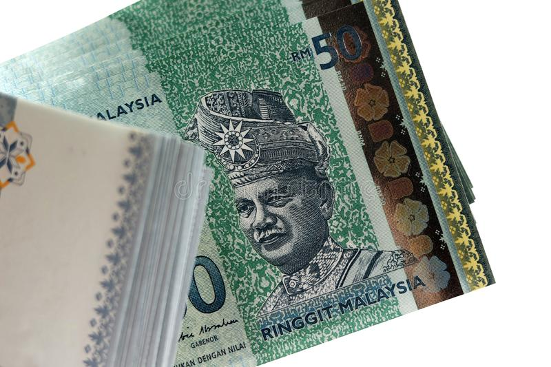 Closeup Of The First Malaysian King On A RM50 Malaysian Banknote. Selective focus on the first Malaysian Agong or King on a pile of RM50 Malaysian banknote royalty free stock images
