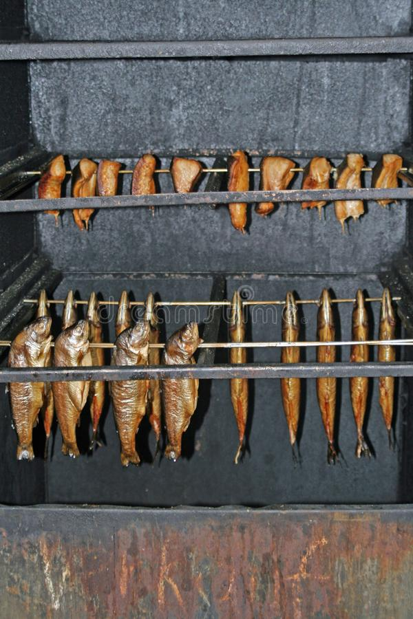 Smoked fishes in a smoker royalty free stock photos