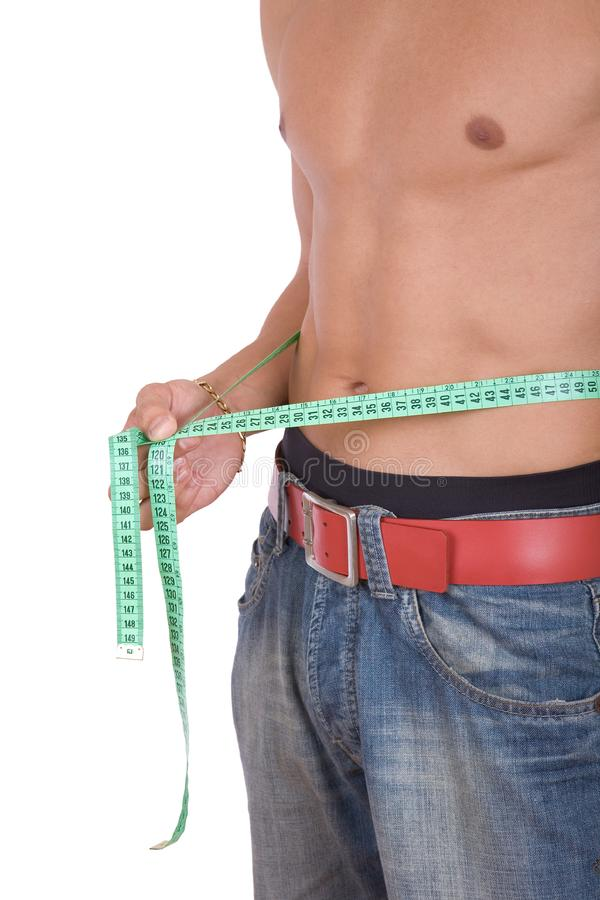 Closeup of fit boy in blue jeans stock image