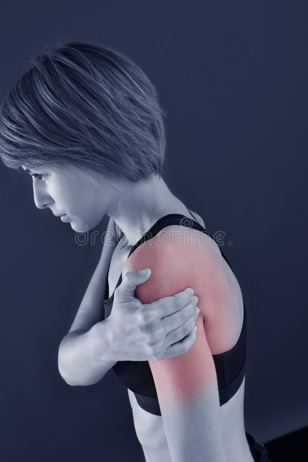 Closeup of fitness woman with shoulder pain stock images