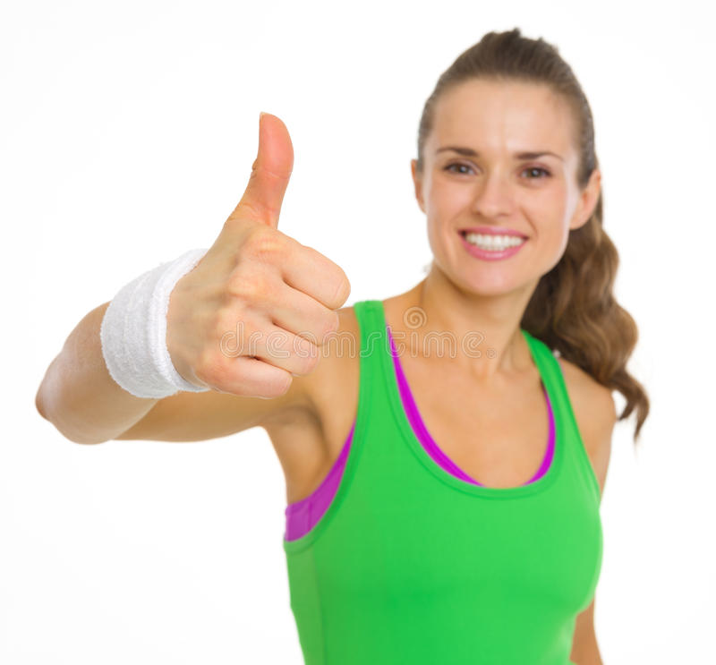 Closeup on fitness young woman showing thumbs up