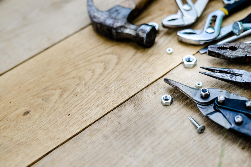 Closeup flat lay of tools on a wooden surface texture, view top stock photography