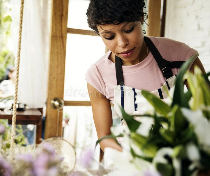Closeup of Flower shop owner woman royalty free stock photo