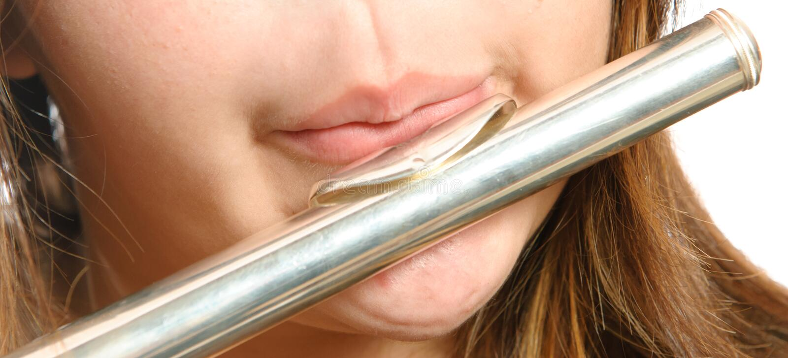 Closeup Flute Blowing. Closeup view of the way you are supposed to blow on the mouth piece of a flute for it to make noise stock images