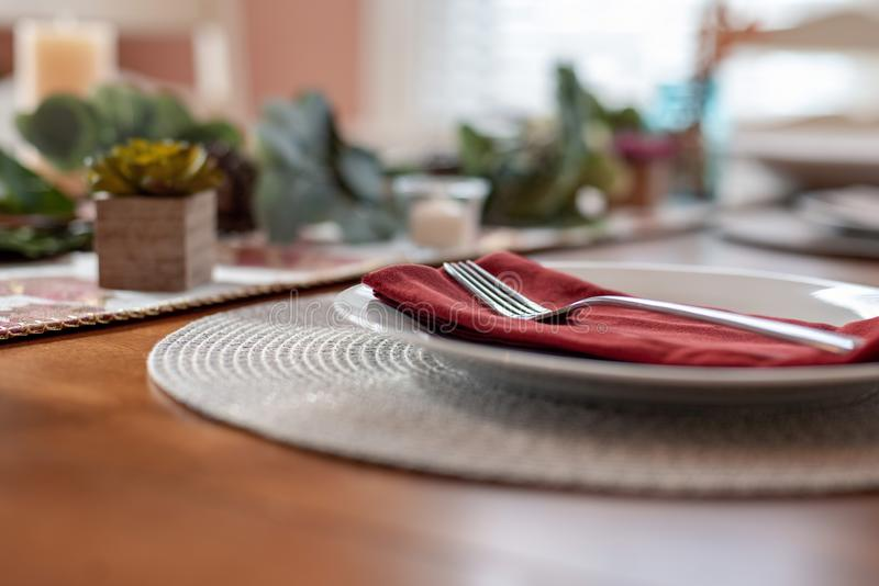 Closeup of fork and plate on table at home stock photos
