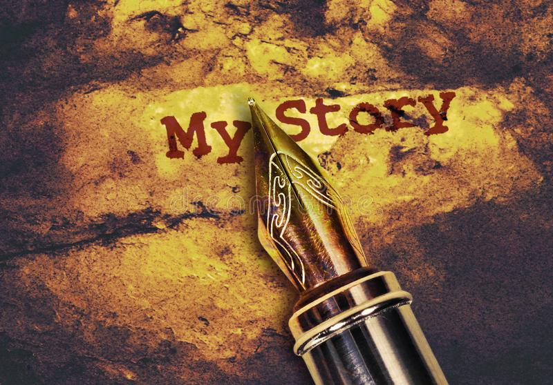 Pen and text My Story. Closeup of a fountain pen and text My Story on golden background royalty free stock images