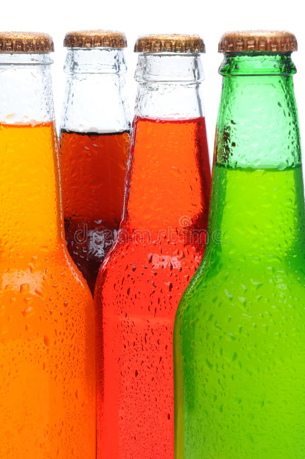 Closeup of Four Soda Bottles. Closeup of four assorted soda bottles with condensation. Vertical format over a white background stock images