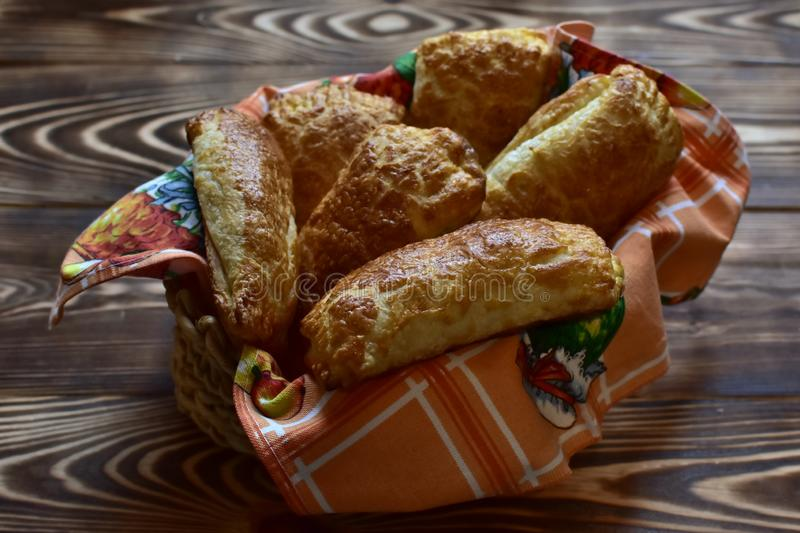 Fresh home made tasty pastry in a plate on a dark wooden natural table royalty free stock photos