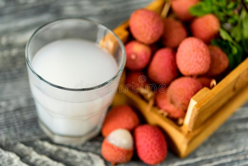 Closeup of fresh lychee juice with fruits stock images