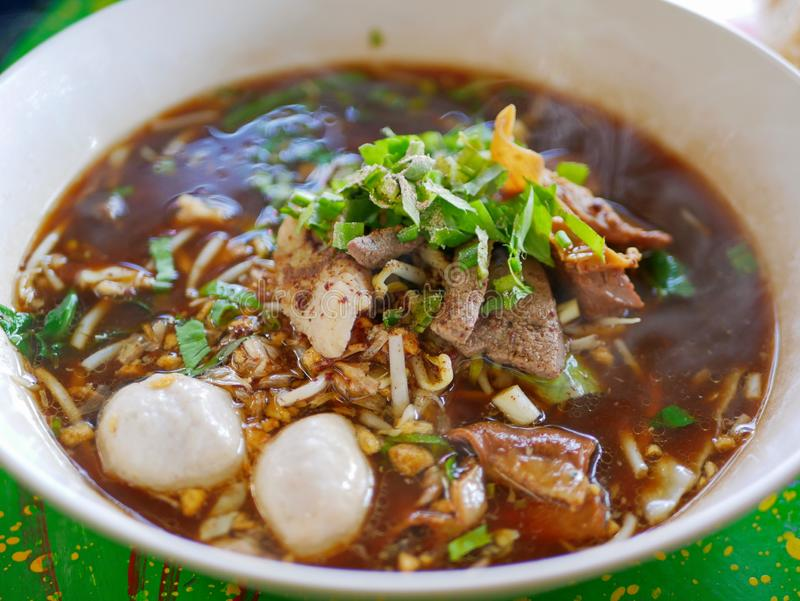 Fresh noodles soup with pork and its tasty thick broth Guay Tiao Nam Tok Moo - delicious and healthy street food in Thailand stock photos