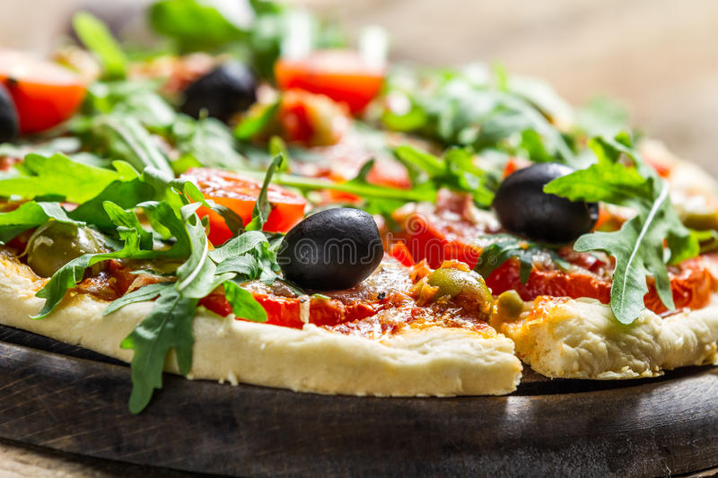 Closeup of fresh pizza with black olives stock image