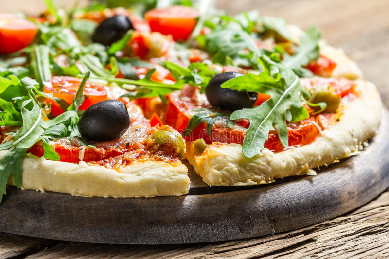 Closeup of fresh pizza with vegetables stock image