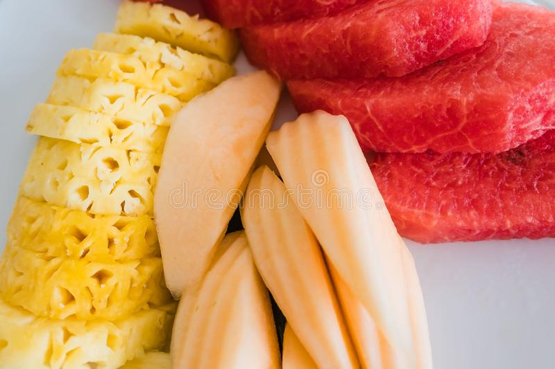 Closeup Fresh tropical fruits , Pineapple, Cantaloupe and Watermelon on a plate.  royalty free stock image