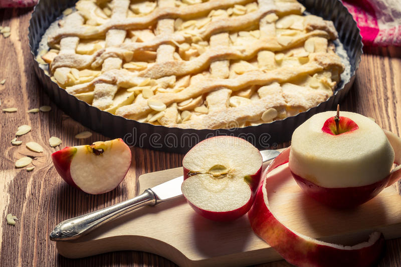 Closeup of freshly baked apple pie and apples stock image