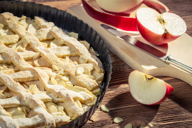 Closeup of freshly peeled apples and apple pie royalty free stock images