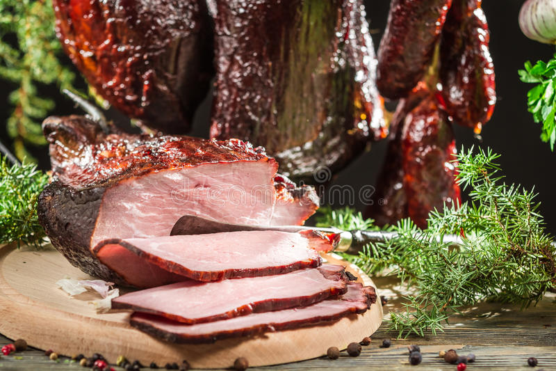 Closeup of freshly smoked ham in a rural smokehouse royalty free stock photos