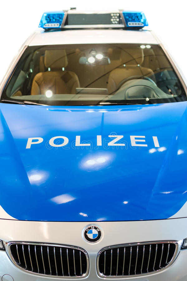 Closeup front view of new modern German police car. MUNICH, GERMANY - DECEMBER 27, 2013: Closeup front view of new modern German police car, announced in BMW stock photo