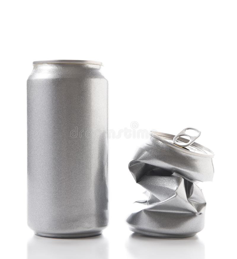 Closeup of a full aluminum can and one crushed empty can. Cans have no label stock photos