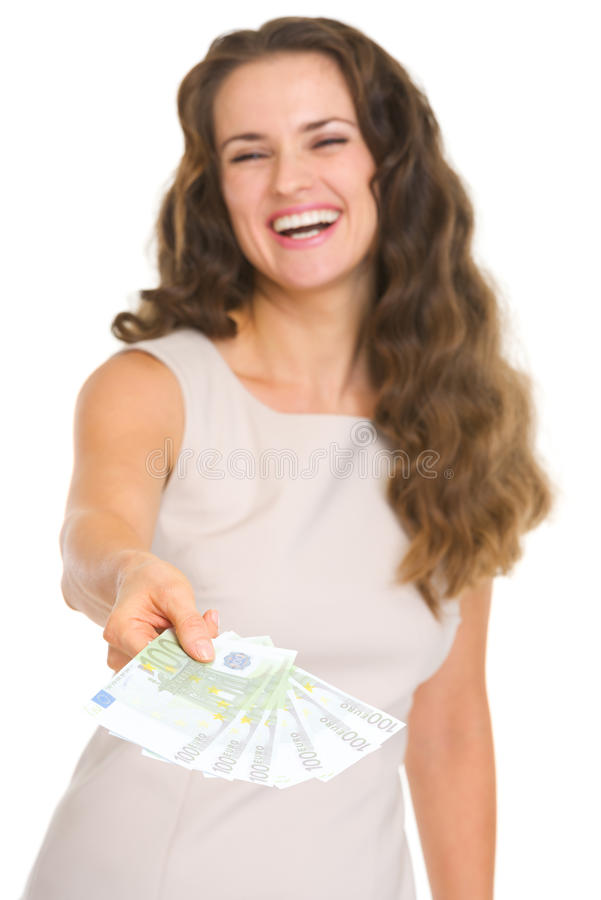 Closeup on fun of euros in hand happy young woman royalty free stock image