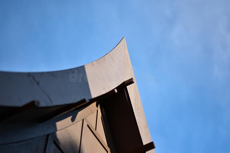 Closeup gable roof of traditional Thai style house with clear blue sky. stock images