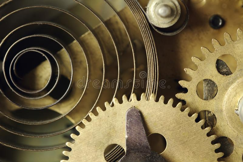 Closeup of gears and cogs clockwork and clock springs. Inside me stock photo