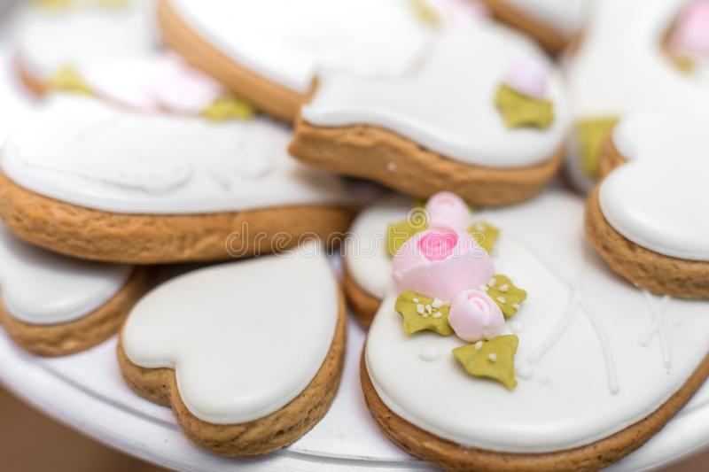 Closeup of gingerbread cookies in a white glaze. Stylish pastries as a decoration for the holidays.  royalty free stock photography