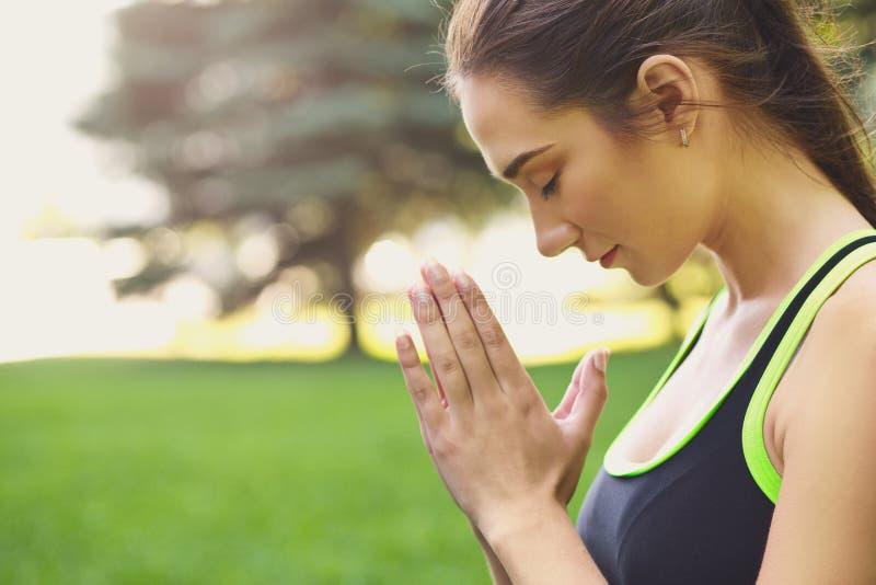 Closeup of woman practicing yoga sitting in padmasana stock images