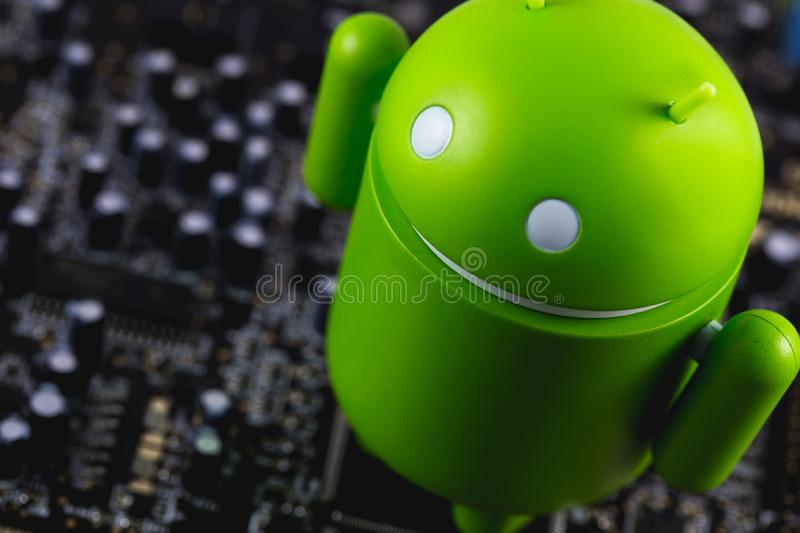 Google Android figure on the circuit board stock photo