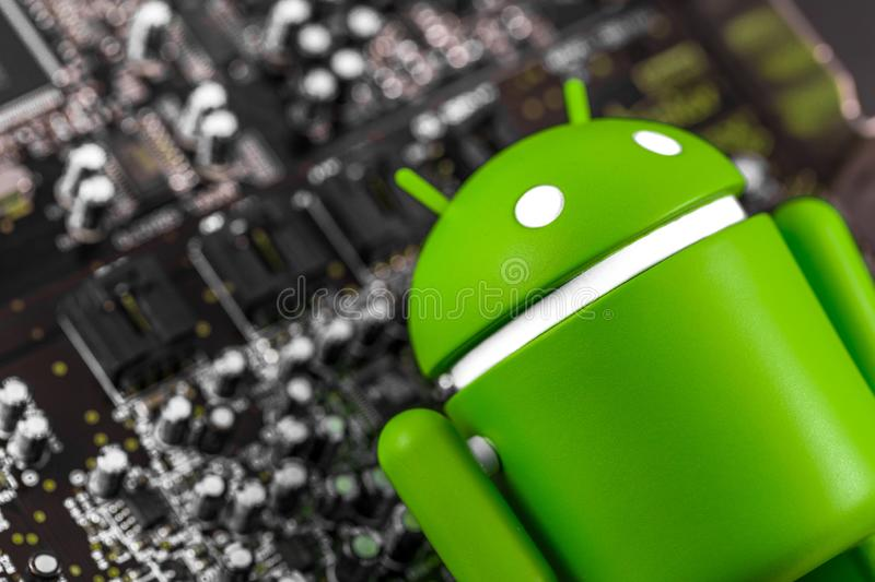 Google Android figure and circuit board. Google Android is the operating system for smartphones, tablet computers, and royalty free stock images
