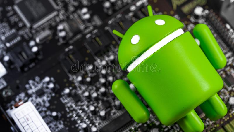 Google Android figure with circuit board royalty free stock photo