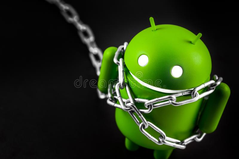 Google Android figure with metal chain stock photography