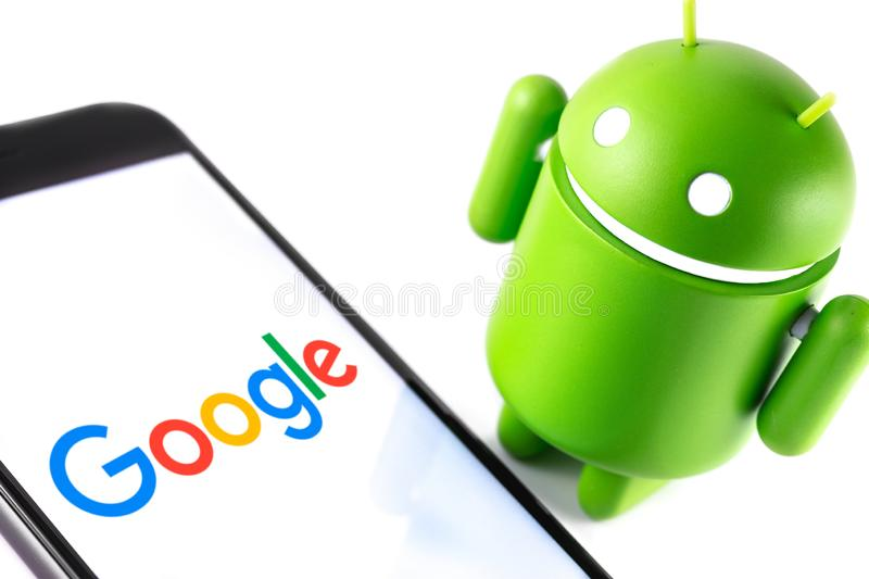 Google Android figure and smartphone with Google logo stock photos