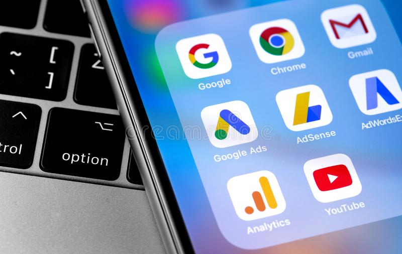 Google services Chrome, Gmail, Ads, AdSense, AdWordsExpress, Analytics, Youtube icons app. On smartphone screen. Google is the biggest Internet search engine in stock image