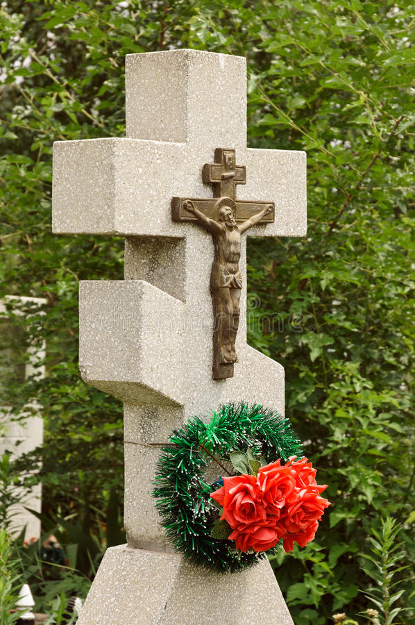 Closeup Of Granite Cross With Crucifix Royalty Free Stock Photos