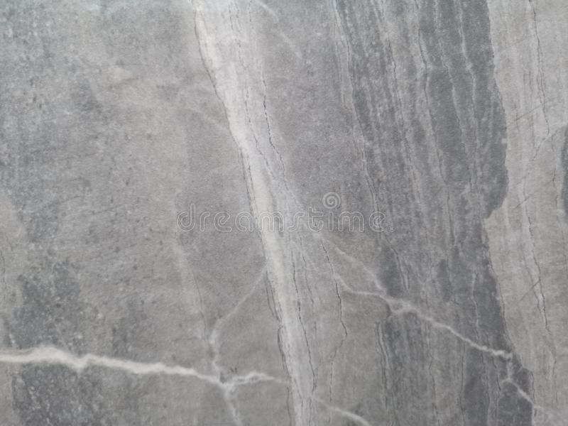 Granite stone wall gray color rough surface texture material background royalty free stock image
