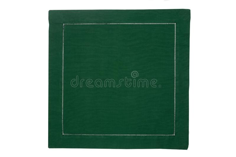 Closeup of a green napkin or tablecloth isolated on white background. Kitchen accessories.  royalty free stock photography