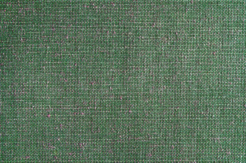 Closeup Green with pink color fabric texture. Geen fabric pattern design or upholstery abstract background.  royalty free stock image