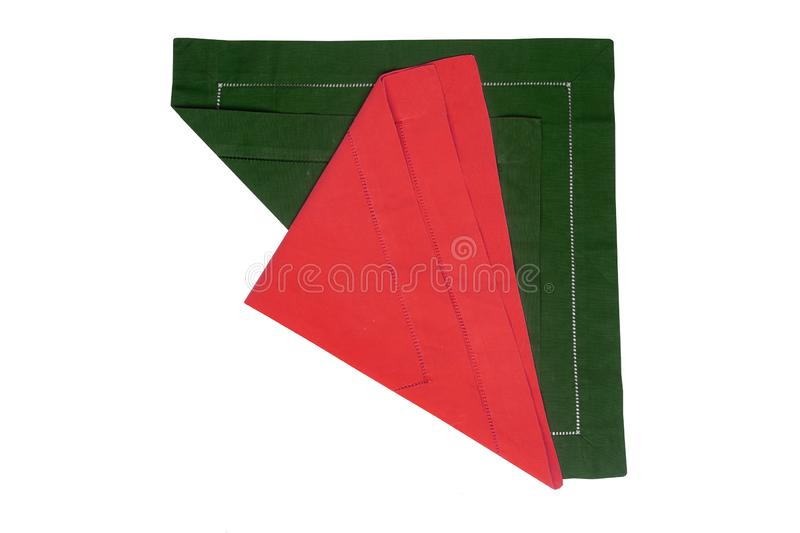 Closeup of a green and a red napkin or tablecloth isolated on white background. Kitchen accessories.  royalty free stock photography