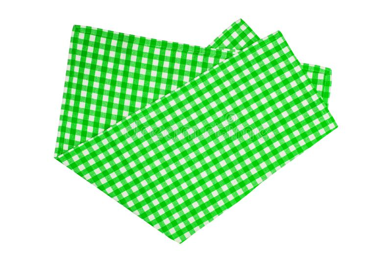 Closeup of a green and white checkered napkin or tablecloth isolated on white background. Kitchen accessories.  royalty free stock photo