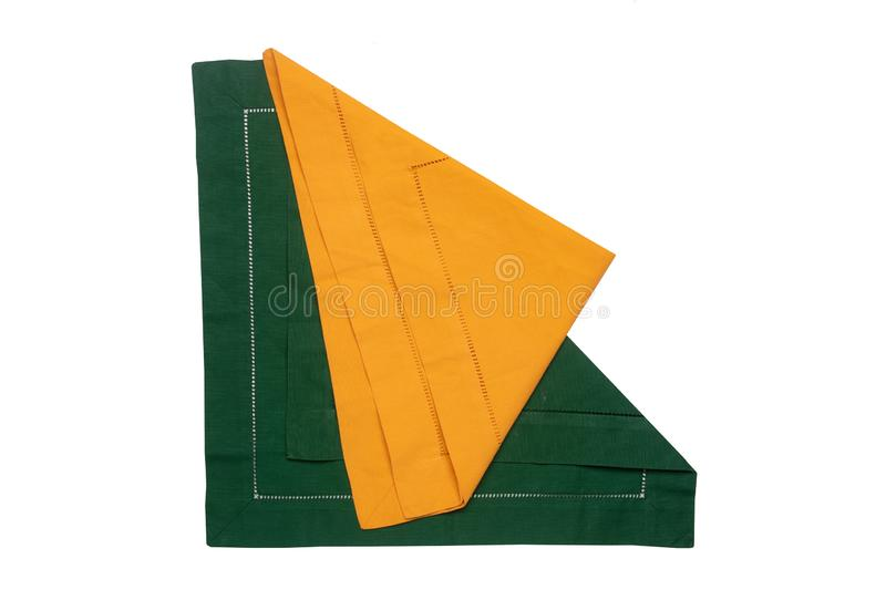 Closeup of a green and a yellow napkin or tablecloth isolated on white background. Kitchen accessories.  stock images