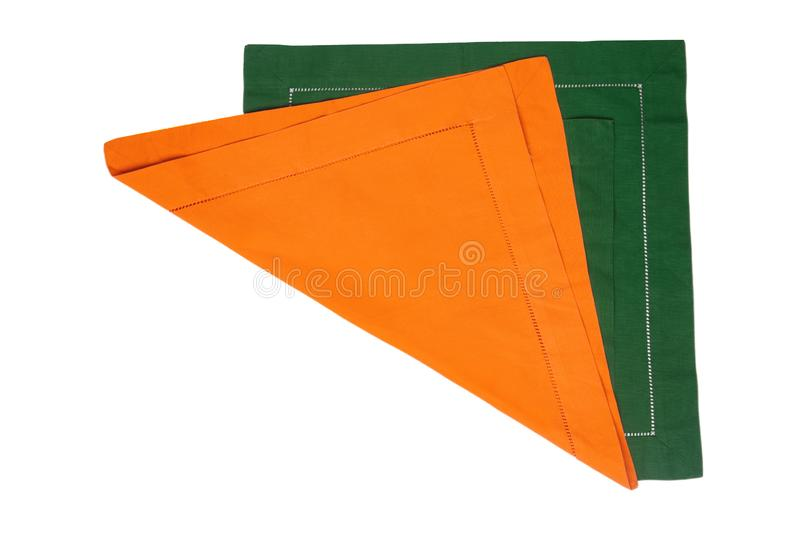 Closeup of a green and a yellow napkin or tablecloth isolated on white background. Kitchen accessories.  royalty free stock photo