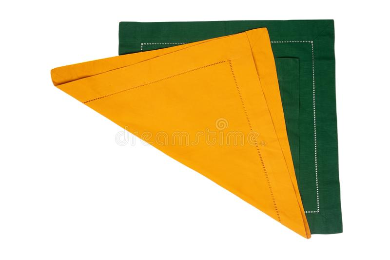 Closeup of a green and a yellow napkin or tablecloth isolated on white background. Kitchen accessories.  royalty free stock photography