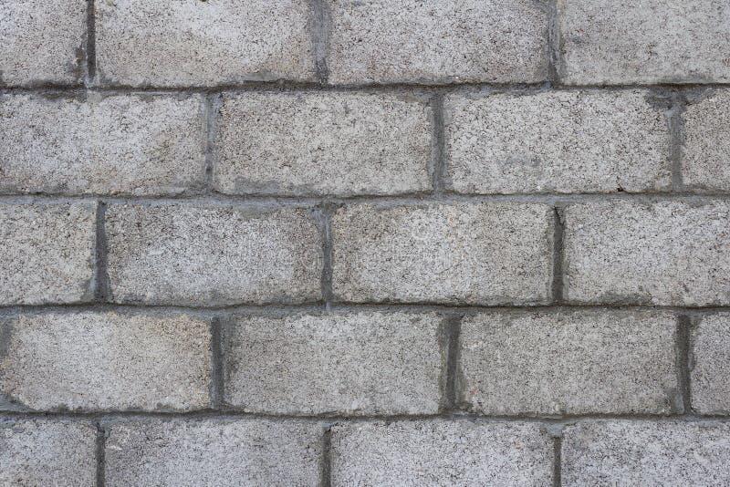 Closeup of grey block wall. stock image